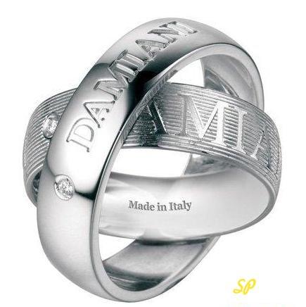 элегантные обручальные кольца коллекции Orbital Bridal фирмы Damiani из белого золота