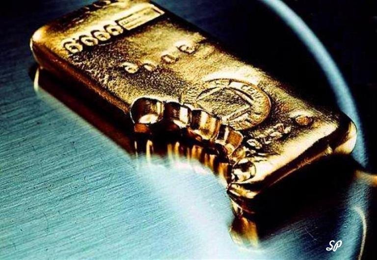 Слиток золота со следами зубов