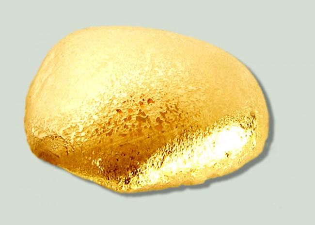 Золотая капля крупным планом