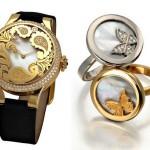 Золотые часы, 2 кольца (серебряное и золотое) на белом фоне