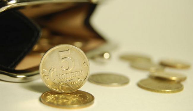 Монеты, высыпающиеся из кошелька