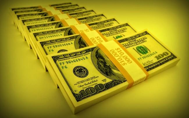Пачки купюр долларов США в золотом цвете