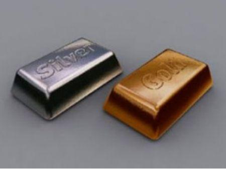 Слитки золота и серебра