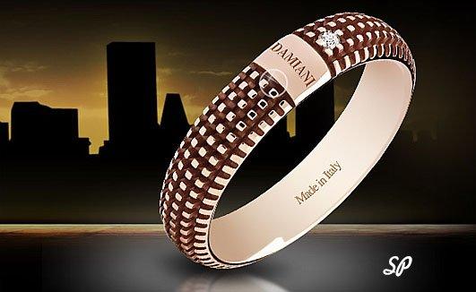 оригинальное кольцо из розового золота фирмы Damiani с крупным бриллиантом