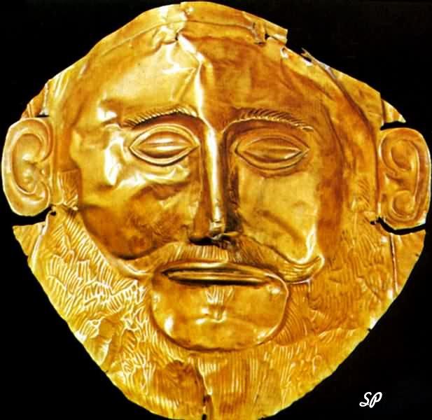 Золотая пластинка на черном фоне в виде маски, изображающая мужское лицо с закрытыми глазами