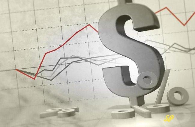 Значки процента и доллара на фоне графиков