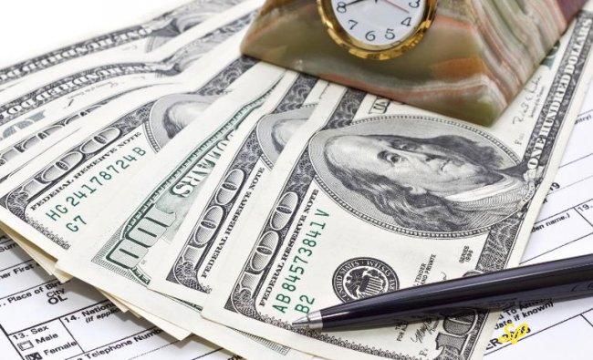Купюры долларов США крупным планом