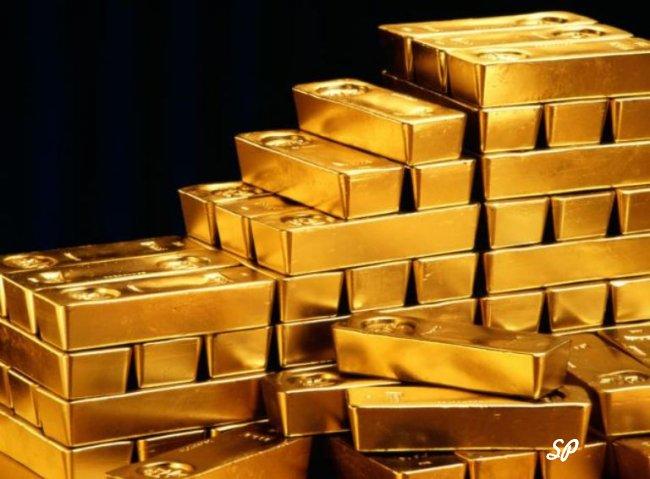 Стопки золотых слитков