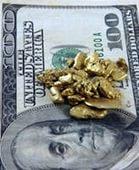 Золотые грануслы поверх 100-долларовой купюры